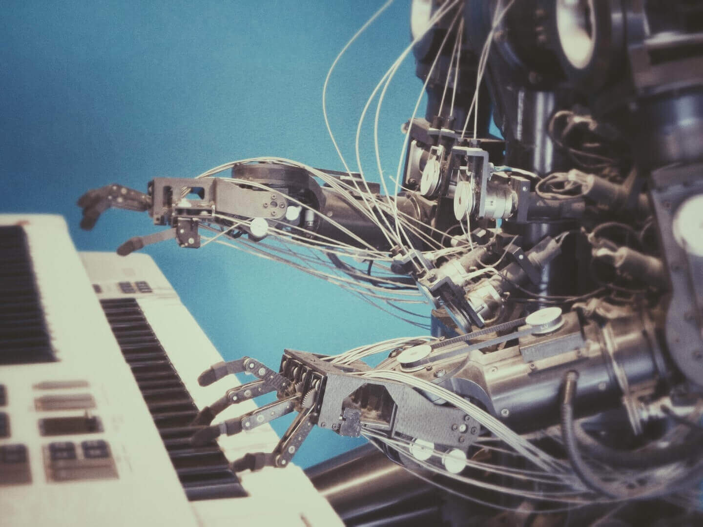 human looking robot playing the piano